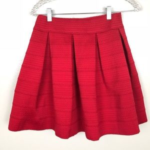 NWOT Express Red pleated flare skirt size M